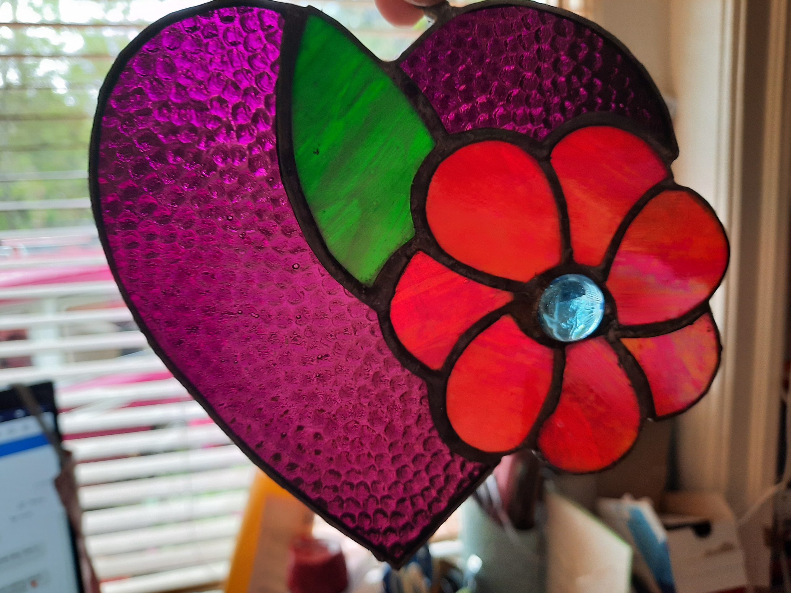 stained glass heart interconnected with a generic flower