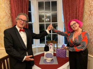 hubby and i with our alternative none wedding cake