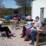students enjoying a break in the sunshine