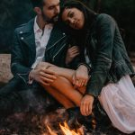 photo by laure rader via unsplash - romantic couple by a camp fire