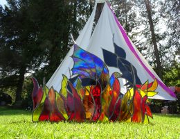 stained glass dragon in front of tepee